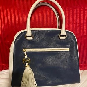 Michael Kirs blue and white bag with MK tassel